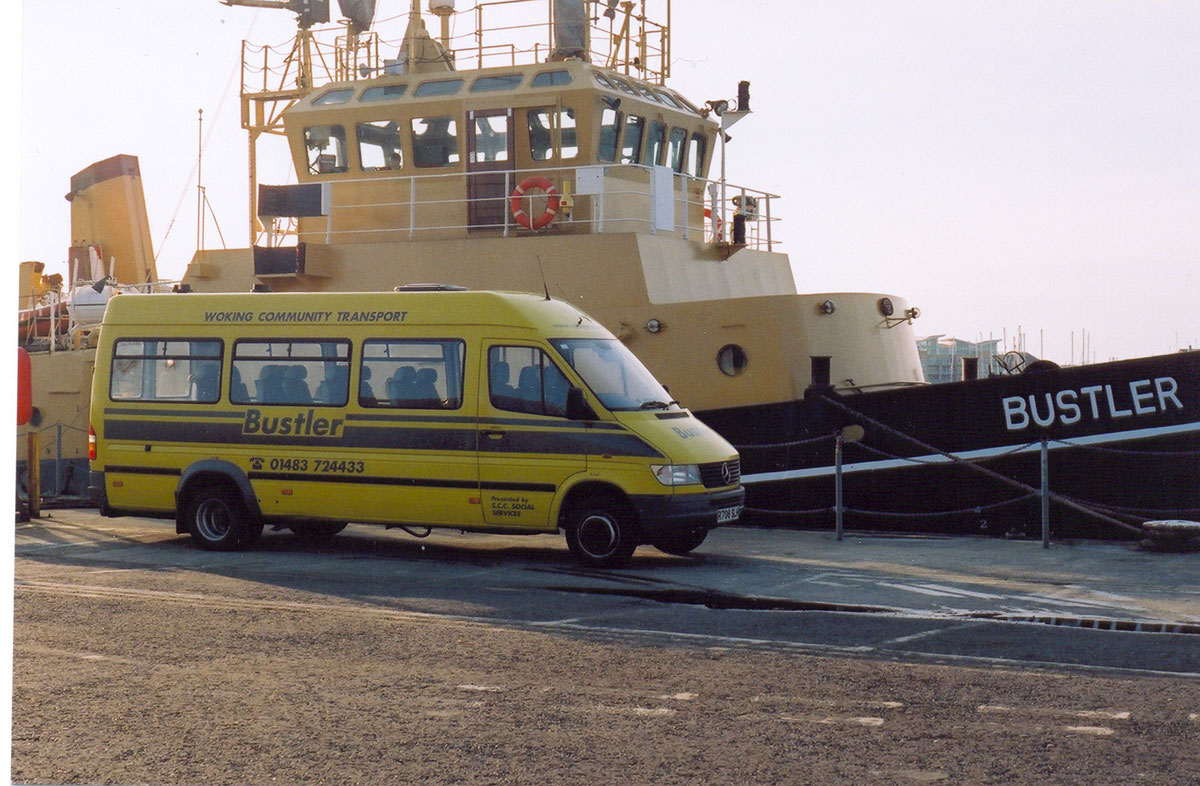 One Bustler bus and one Bustler Tug image