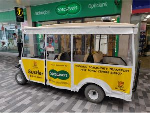 BustlerTown Buggy Image outside of Specsavers